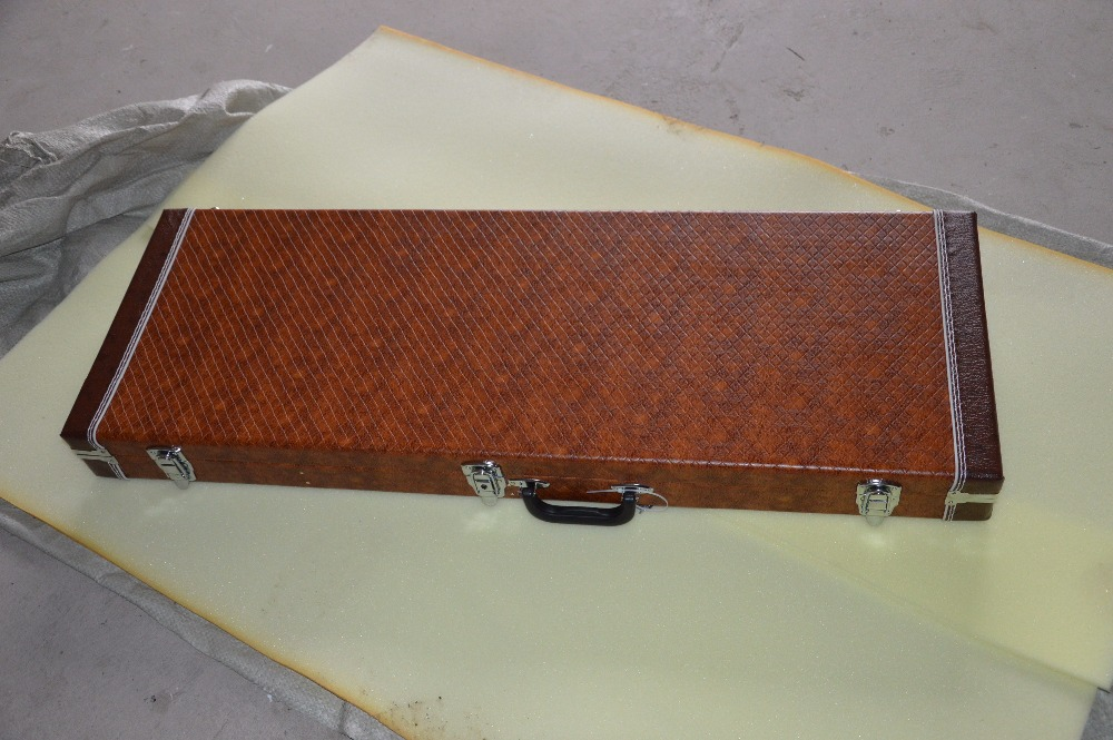 Human Electric guitar brown suitcase, cheap price, first-class quality, a variety of styles to choose fromBrown shell, rectang hot sale suitcase cheap electric guitar suitcase cheap price