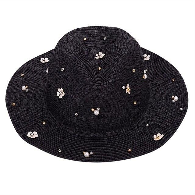 Nueva primavera verano sombreros para las mujeres flor ala ancha Sombrero  de Panamá visera playa flor perla remache sombrero de paja 4023d1fc378