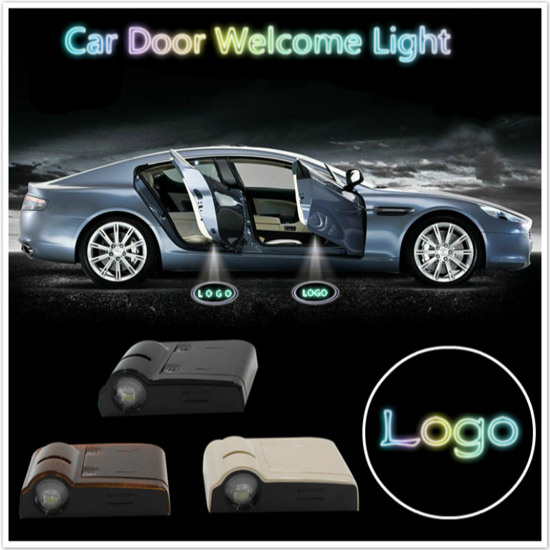 цена на JURUS hot sale wireless car door ghost shadow welcome light emblem projector laset for toyota for vw for ford for nissan logo
