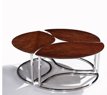 Stainless steel table. Contracted and contemporary living room furniture. The art of tea table