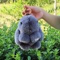 Anillo Dominante De La Manera Llavero de Piel Real Auténtica Real Rex Pieles de Conejo súper Meng pequeño Bolso colgante Del Encanto Del Coche Etiqueta Linda del Conejo de Juguete muñeca
