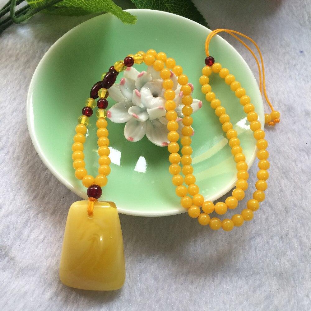 Optimisation naturelle de l'huile de poulet jaune chandail chaîne pendentif collier ambre cire d'abeille pierre pendentif