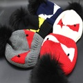 2016 Winter Hats Small Monster Eye Pattern Hair Ball Knitted Cap Roll Knitting Wool Cap Men Women's hat