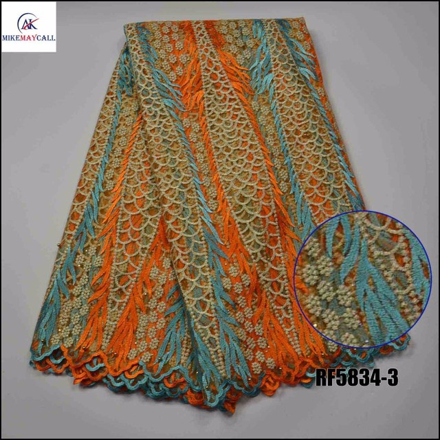 Hot sell net guipure lace fabric 2016 chemical lace embroidery fabric with  holes in orange