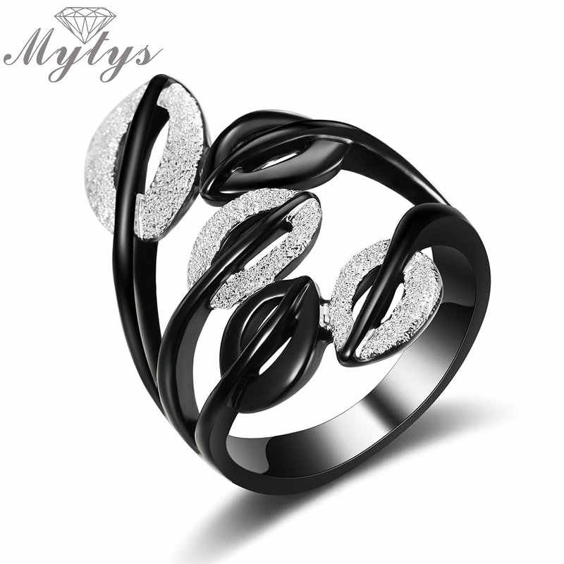 Mytys Black Silver Two Tone Rings for Women Fashion Party Leaf Hollow Out Girls Rings Gift Wholesale Drop Shipping  R1985