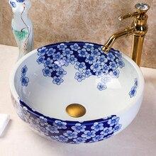 Керамическая синяя и белая раковина для ванной