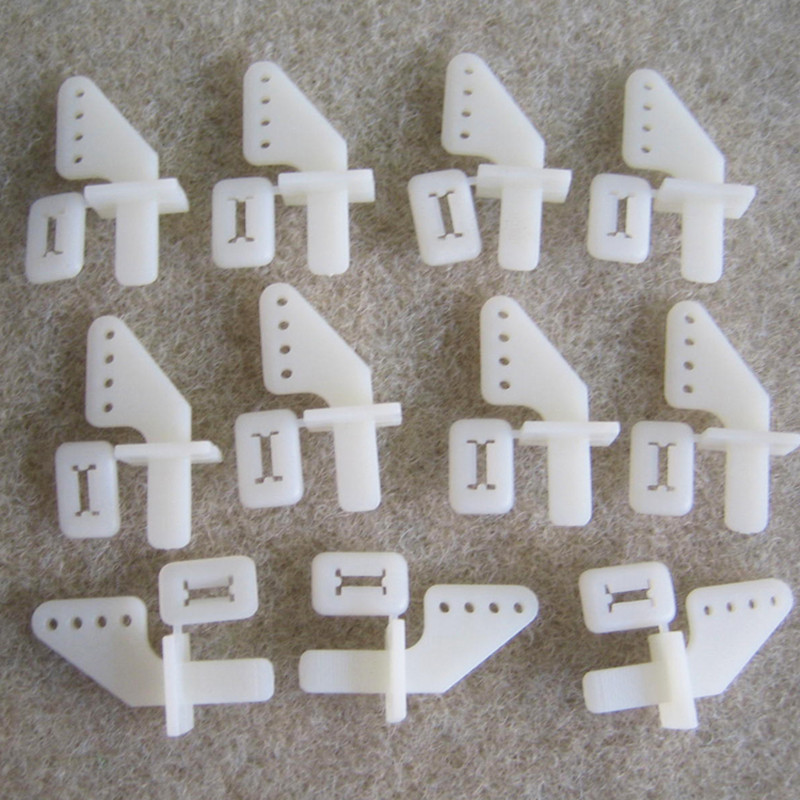 Andralyn 200 pcs Nylon Pin Horns 21x11 mm (4 Hole) For RC Model Airplane Parts Remote Control Foam Electric Plane free shipping