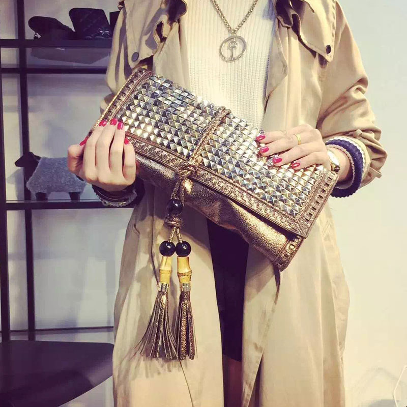 women bag Retro rivet tassel hand bag new handbag Embossed leather handbag  women's clutch bag