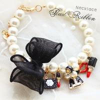Envío Gratis ajustable collar de perro grande de lujo perla colgante arco negro pequeño animal joyería brillante accesorios para mascotas