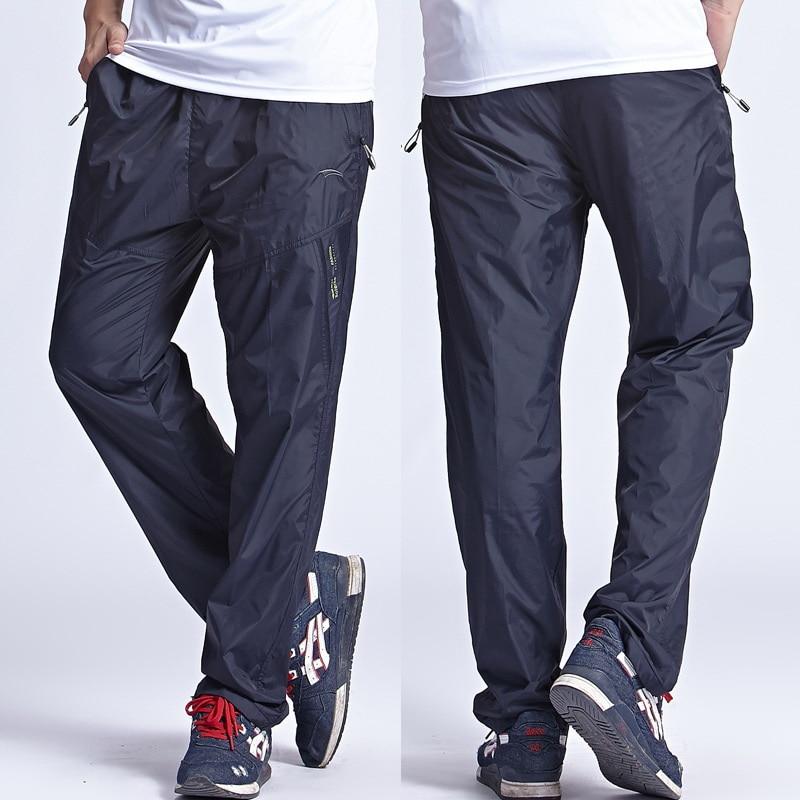 2018 Nuevos pantalones de secado rápido para hombres Pantalones activos para exteriores más el tamaño 6XL Pantalones para hombres largos Cintura elástica activa Hombres Pantalones de ejercicio, PA214