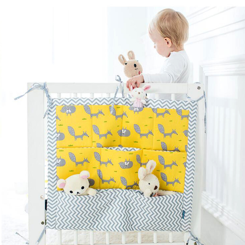 free shipping Cartoon Nursery Baby Hanging Storage Bag Baby Crib Bed Cot Organizer Baby Diaper Pocket Newborn Baby Bed Set