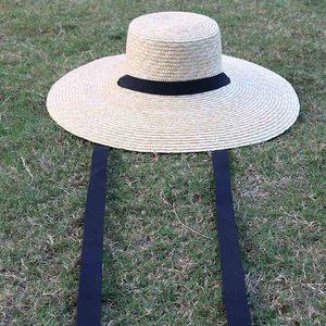 Image 2 - Venta al por mayor sombrero de paja de ala ancha mujeres gorro de playa de verano con lazo negro señoras nueva moda platillo sombrero de sol sombreros Kentucky Derby