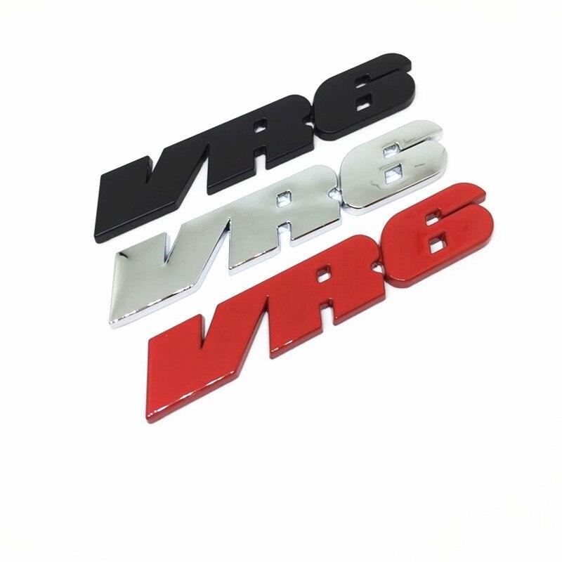 Placa cromada adhesiva con el logotipo de Quattro