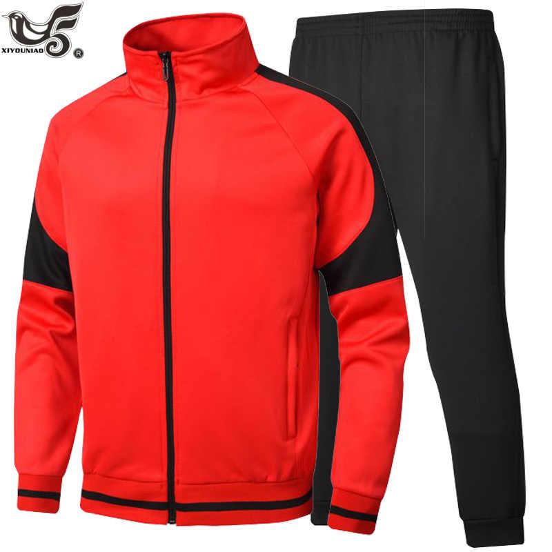 新しい男性セットカジュアルスポーツウェアスーツスエットシャツトラックパッチワークスポーツジャケット + パンツ 2 本トラックスーツの男