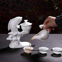 New Jingdezhen Fish Porcelain Dehua Kung Fu Tea Set Cups Automatic White Ceramic Hollow Transparent Blue and White Tea Pot Cup