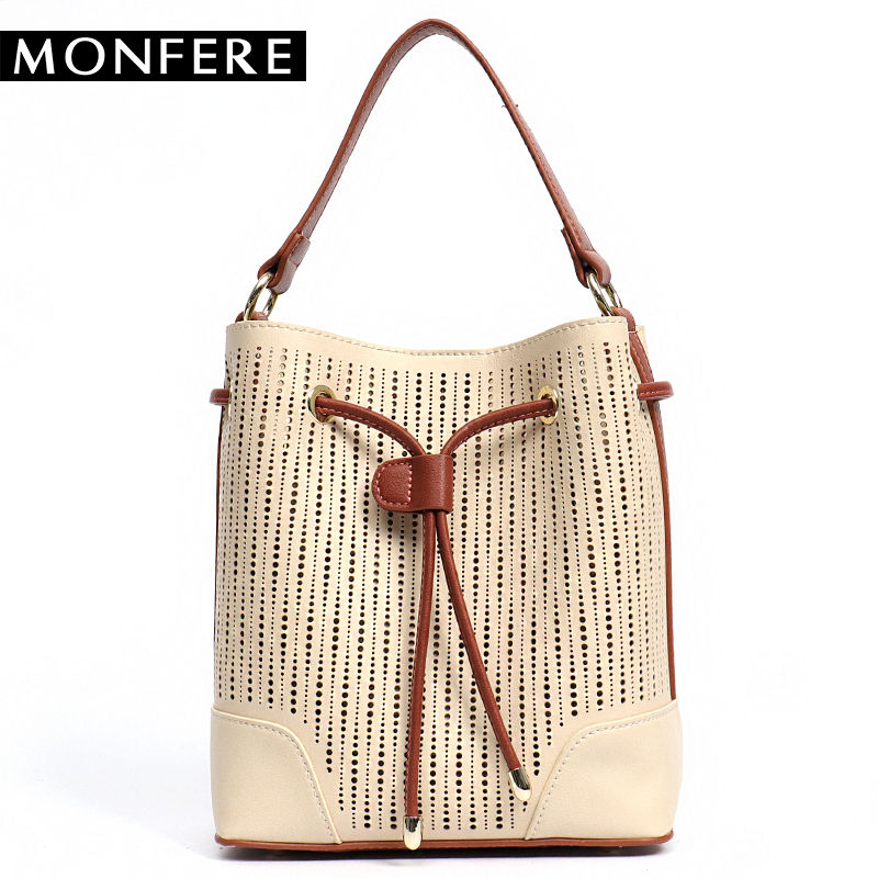 MONFERE 2017 new style fashion hollow out drawstring bucket bag cutout pattern mixed color tote women's shoulder handbag punk style pure color hollow out ring for women