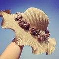 Venta caliente Coreano Sun de la Paja Sombreros Para Mujeres Niñas Casquillo de la Playa Anti-Ultravioleta Floppy Cap de verano Para Las Señoras de La Flor de Paja Sombrero De Ala Ancha