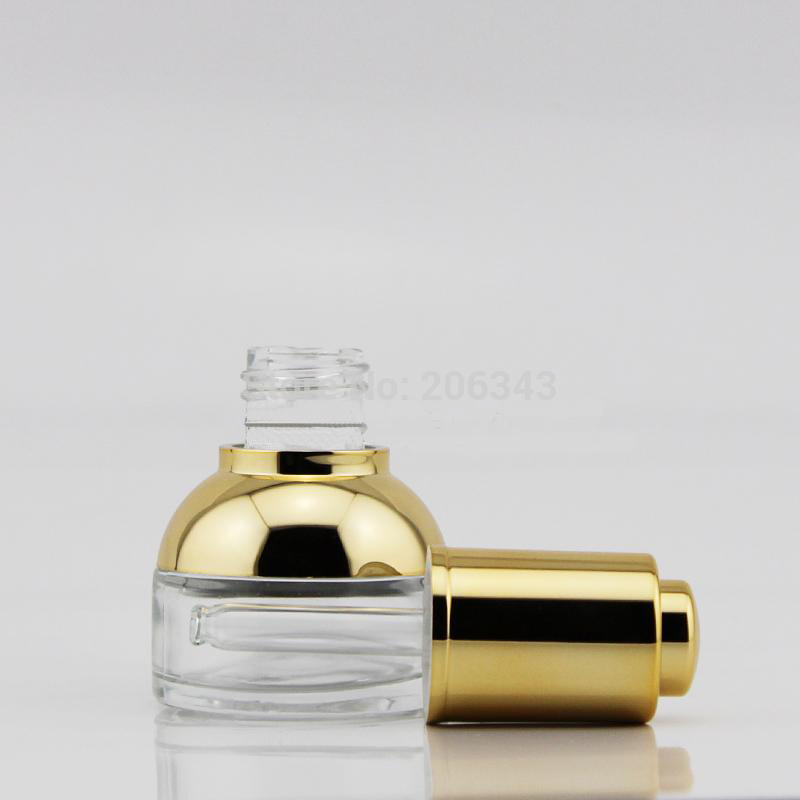 NEW ARRIVAL 20ml transparent glass dropper bottle with GOLD shoulder and GOLD press dropper ,white bulb glass bottle