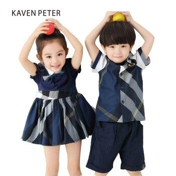 e50fc422e Vestido de niña azul a cuadros vestido y Bowknot verano niñas puff manga  vestido uniformes escolares hermano y hermana ropa 3- 7 T