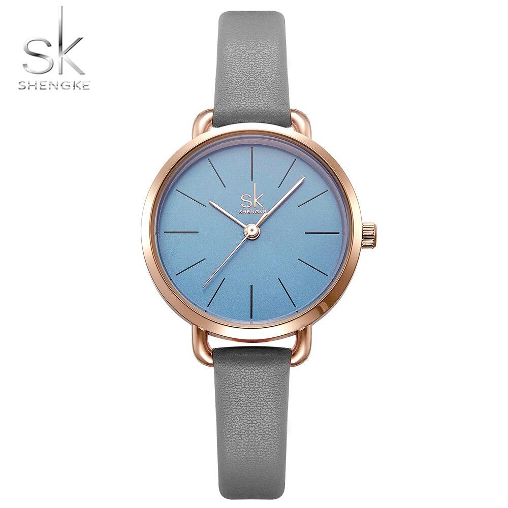 SHENGKE Neue Casual Stil Damen Uhren Grau Leder Strap Grün Einfache Zifferblatt Frauen Quarz Uhren Mit Geschenk Box Reloj Mujer