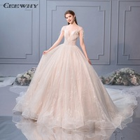 CEEWHY O Neck Crystal Beaded Wedding Gown Robe de Mariee Feather Bride Dress Champagne Wedding Dress 2019 Vestido de Novia