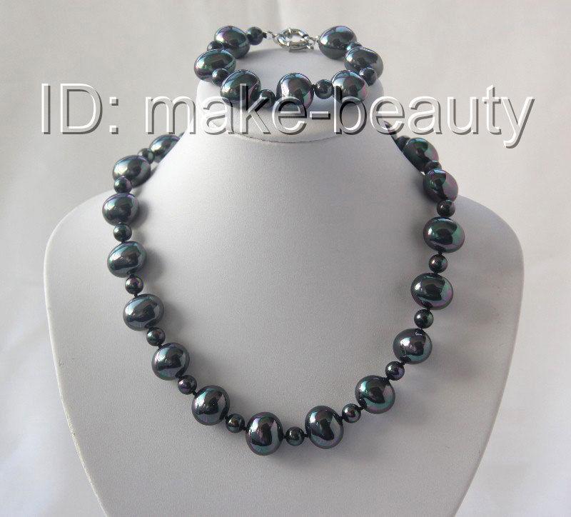 Superbe bracelet en perles de mer noires baroques de 19mm h2637