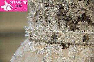 Image 3 - Zarif A Line dantelli fransız gelinlik Ayrılabilir kemer Şampanya Robe De Mariage Vestido De Noiva Mide nova MTOB1703