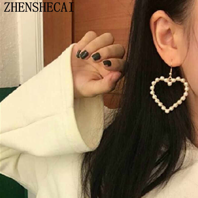 2017 New Trendy Heart Hollow Stud Earring With Bead Decoration Popular Gift for Women Girl Fashion Jewelry Wholesale e0286