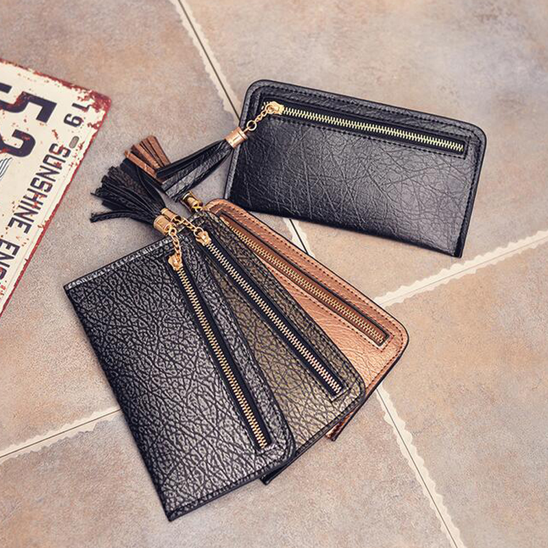 Slim minimalist fashion women Tassel PU leather clutch wallet long section of the crack explosion