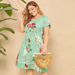 Duży Plus rozmiar sukienka lato drukowane kwiatowy Sexy kobiety sukienka z nadrukiem kolorowe Lady sukienka z krótkim rękawem Letnia sukienka 2
