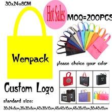 O costume imprimiu o saco não tecido do presente de compras do punho da mão do logotipo para o pano e a forma não tecidos da promoção