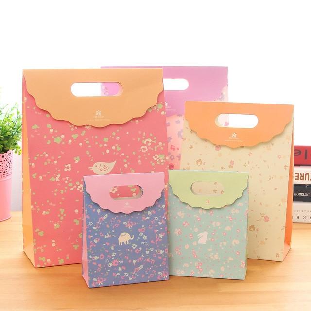 b5f58f0a3de81 9 حقيبة من لطيف ورقة كيس هدية التفاف للأطفال عيد ميلاد ، حزب أكياس هدية فكرة