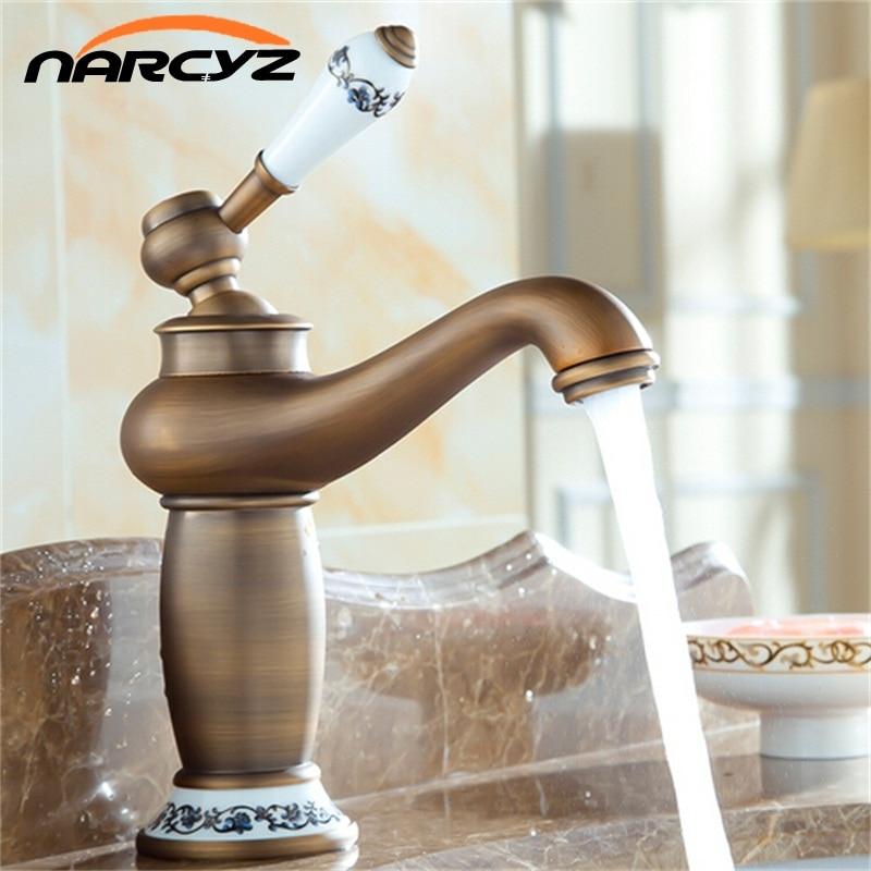 Basin Faucets Mixer Taps Antique Brass Finished Hot and Cold Deck Mounted Porcelain Sink Faucet XT904 недорго, оригинальная цена