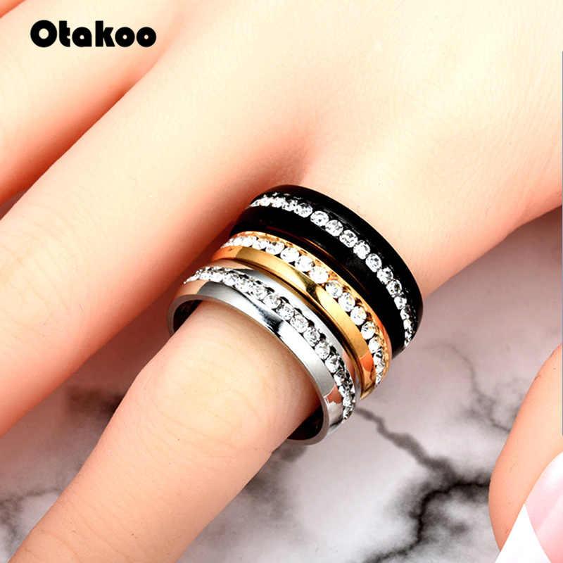 Otakoo ไทเทเนียมแหวนสแตนเลสผู้หญิง Slash สาย CZ แฟชั่นเครื่องประดับขายส่ง