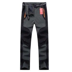 Image 2 - 2020 Nuovi Uomini di Inverno Delle Donne Pantaloni da Trekking Allaria Aperta Softshell Pantaloni Impermeabili Pantaloni Antivento Termico per Il Campeggio Sci Arrampicata RM032