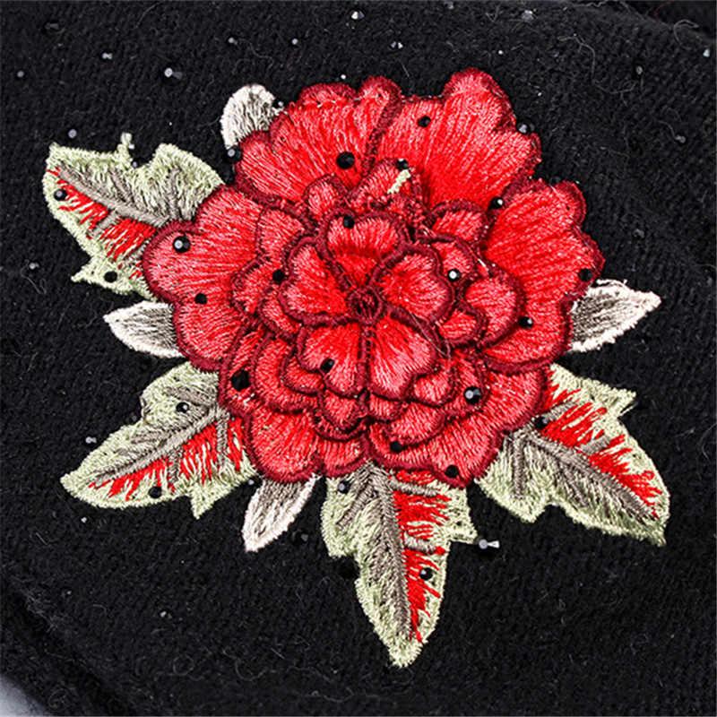 Xthree Nữ mùa đông nón thời trang thêu dệt kim Bò Nữ đi thật cáo lông Pom Pom Mũ len Skullie nón bé gái gorro