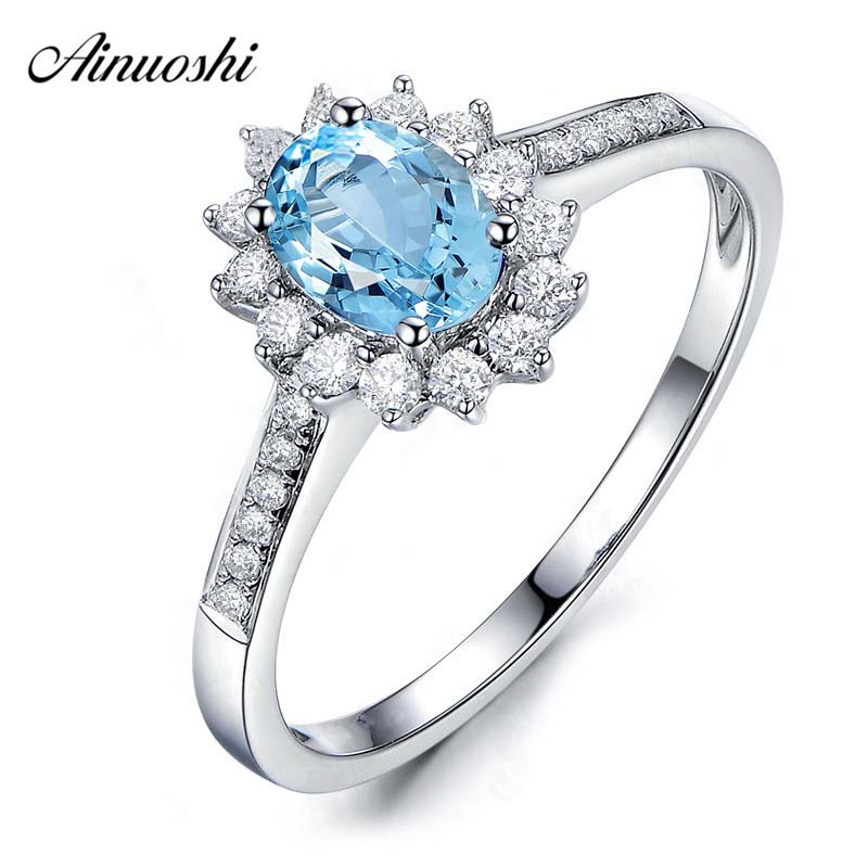 AINUOSHI Pure 925 Sterling Silver Topaz Halo Ring 2 Carat Oval Cut Natural Blue Topaz Ring Trendy Engagement Wedding Ring ainuoshi trendy 925 sterling silver women wedding engagement ring halo 0 5ct emeralded cut ring aniversary gifts anillo de plata