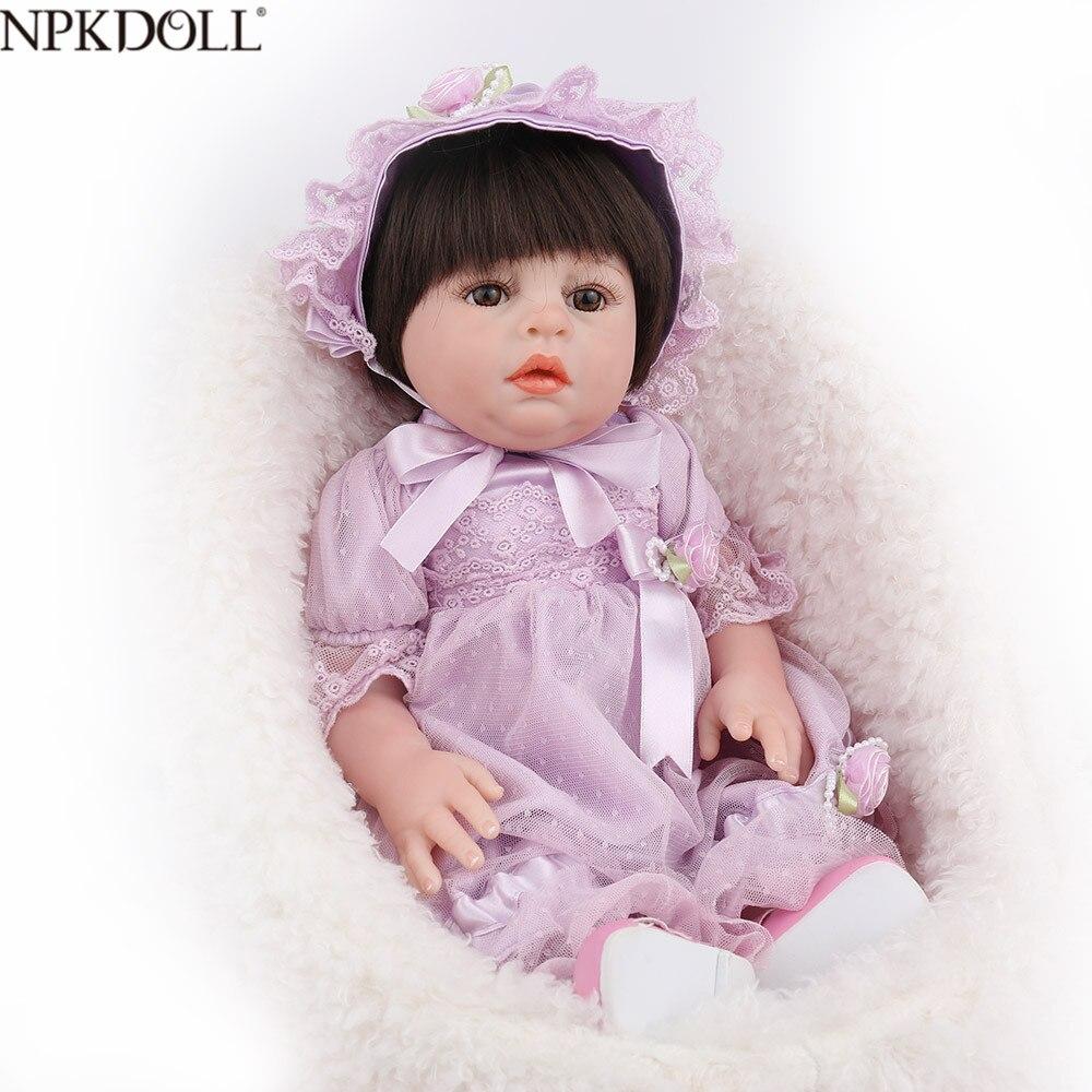 NPKDOLL Reborn bébé poupée fille jouets plein vinyle réaliste réaliste violet robe nouveau-né faux infantile noir cheveux perruques Dollhouse mignon