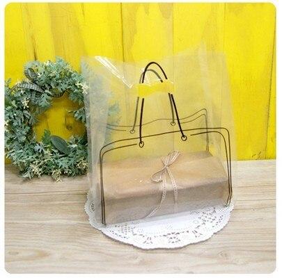 cc0dad1b09b 100pcs wholesales 35*25cm innovative handbag shape gift bag plastic shopping  bag food packing