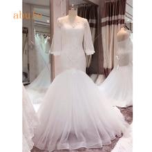 44f33aad1d5d Vintage Long Bishop Sleeves Puffy Mermaid Wedding Dress 2018 Beading  Appliques Sheer Jewel Neck White Bridal