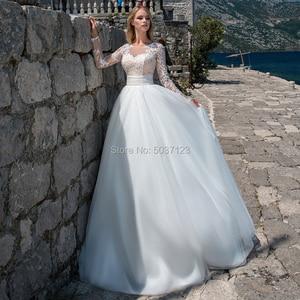 Image 1 - Tule UMA Linha De Casamento Vestidos O Pescoço Botão De Mangas Compridas Rendas Apliques Vestido De Novias 2019 Até O Chão vestido de Noiva para a Noiva