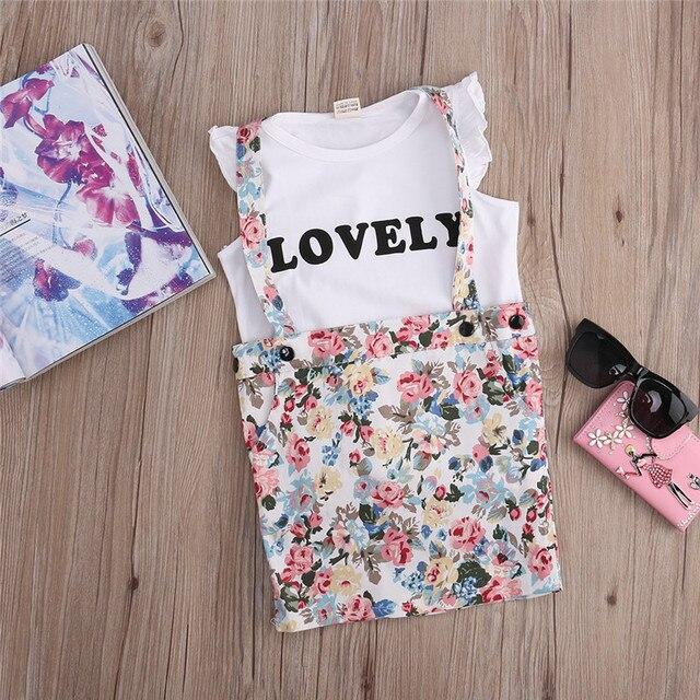 3a9336196aa Bébé Childre Vêtements Ensembles 2 pcs Pour Enfants T-shirt Fille + Floral Bretelles  Jupe