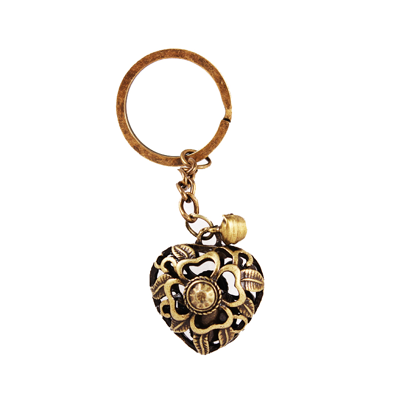 Vintage hollow Heart bell keychain keyring women lovely bag charm hanger  car key holder antique brass plated pendant 10pcs lot-in Key Chains from  Jewelry ... 97589a68b0