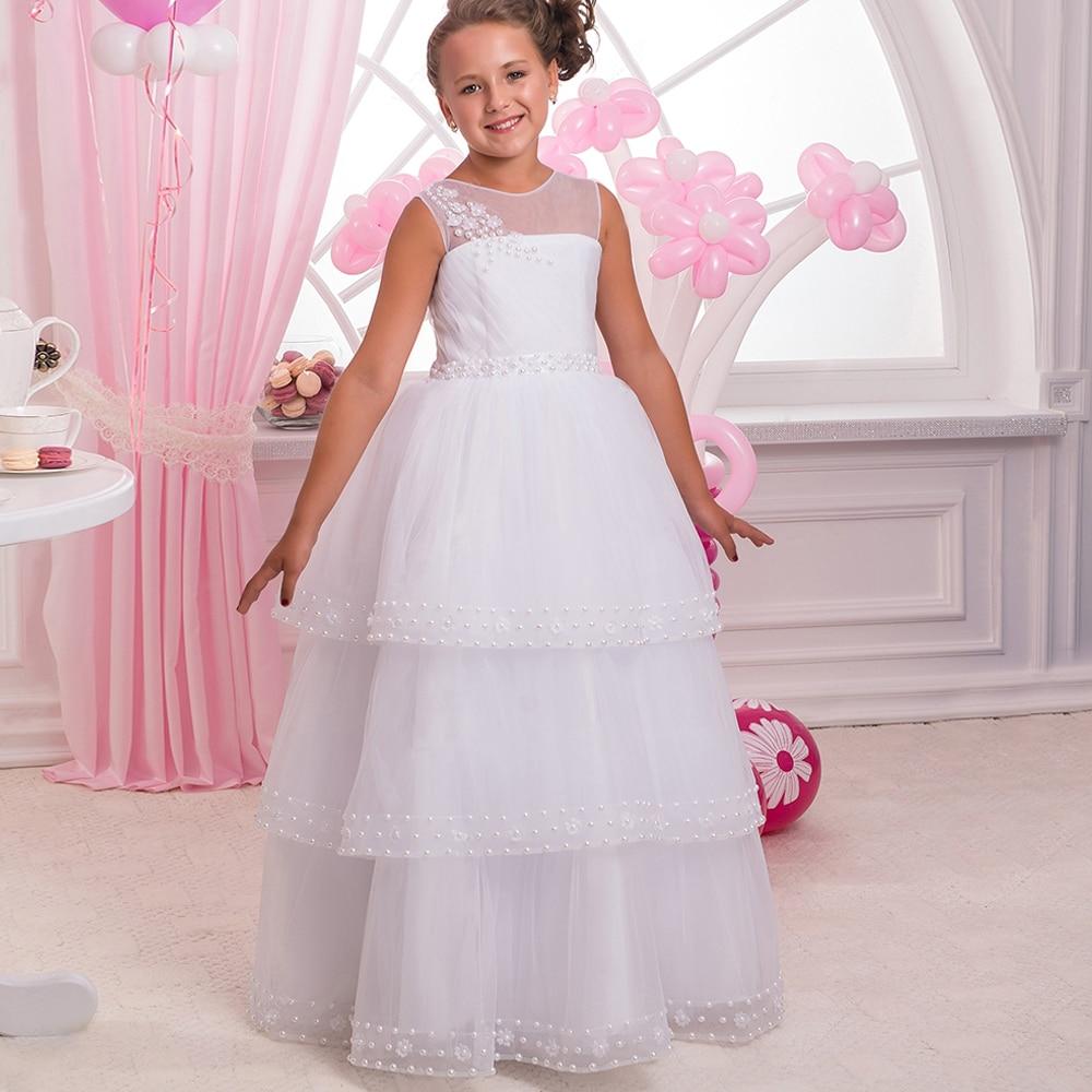 все цены на White Pearls Cheap Flower Girl Dresses 4 Tiers Tulle Ball Gown Sleeveless O-neck First Communion Gowns Vestidos Longo онлайн