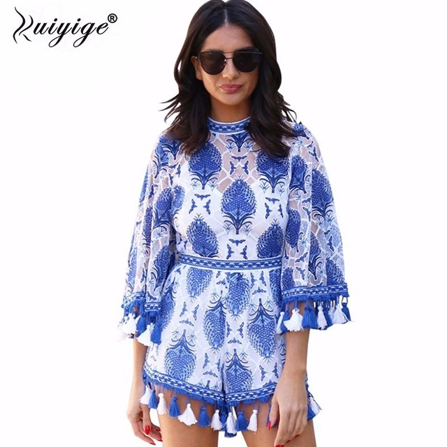 Ruiyige 2018 summer women Rompers Jumpsuit Female lace boho wrapped embroidery half flare sleeves overalls with tassel feminino