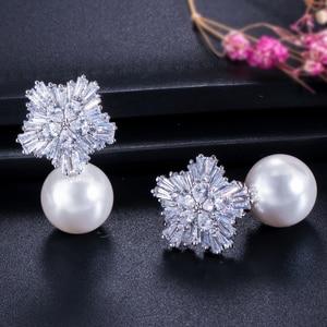 Image 3 - CWWZircons boucles doreilles en fleurs de neige pour femmes, grandes gouttes, en perles blanches, en zircone cubique, cadeau de noël, CZ069, 2020 nouveauté