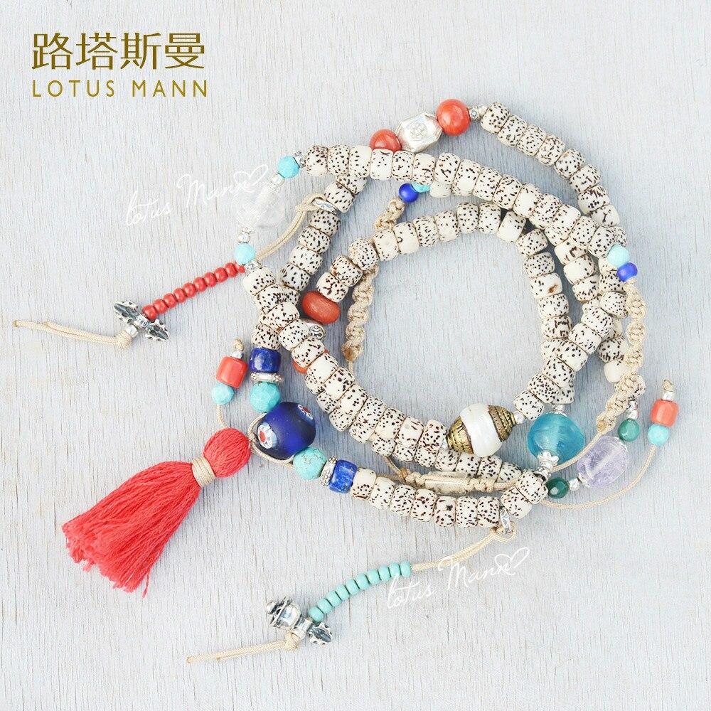 Lotus Mann Hainan laisse densité le long du petit blanc le bodhi quatre tours 108 bracelet de perles