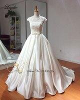 Liyuke lustrous satén o-cuello a-line vestido sin mangas hermoso del arco del cordón sashes backless novia vestidos de novia