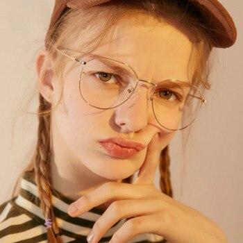 d95debaf3c Vintage gafas de marco de los hombres y las mujeres Retro miopía claro  óptico lente gafas redondas de gozluk Oculos gafas redondas