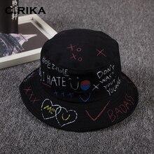 Versión coreana Panamá Boonie cubo sombrero Primavera Verano hombres  mujeres cubo sombrero letra Graffit pescador gorra 645a1263a52